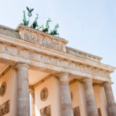The Brandenburg Gate in Berlin with incident sunlight.